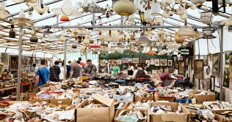 """Berlin, Germany - June 10, 2012: Tourists and locals browse through various used merchandise at Berlin's famous Mauerpark Sunday flea Market."""